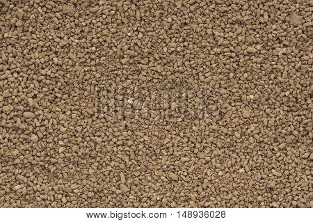 Cocoa granules background texture. brown cocoa powder..