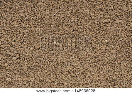 Cocoa granules background texture. brown cocoa powder..