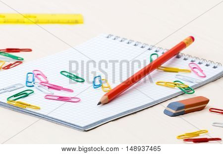Simple pencil Notebook paper clips on a desk