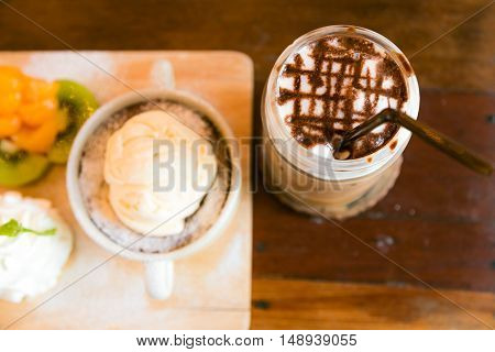 Top View Of Delicious Mocca Coffee With Dessert