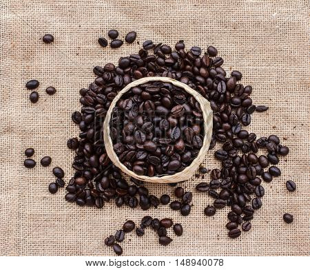 bamboo basket with coffee beans roasted on the sack floor