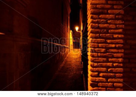 old city narrow streets at night time