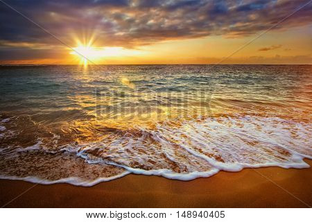 Beach holidays vacation background - calm ocean during tropical sunrise
