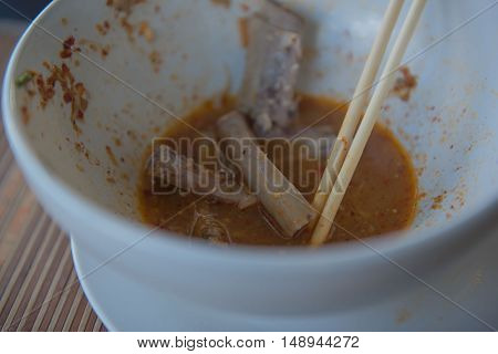 Food Noodle bowl with remaining pork bone . At restaurant