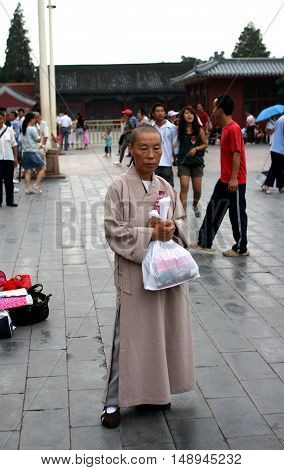 Beijing. China. - August 20, 2009 - Chinese nun about Palace in the Forbidden City in August 20, 2009 in Beijing. China