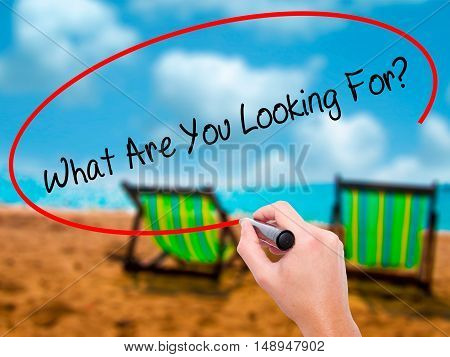 Man Hand Writing What Are You Looking For? With Black Marker On Visual Screen