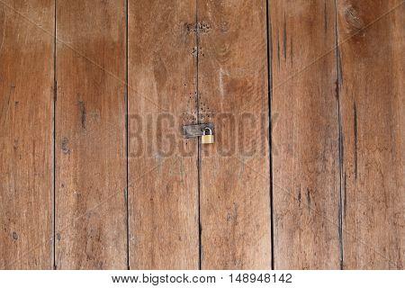 Old wood doorwooden door of Traditional houses in Thailand.