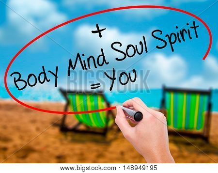 Man Hand Writing Body + Mind + Soul + Spirit = You With Black Marker On Visual Screen