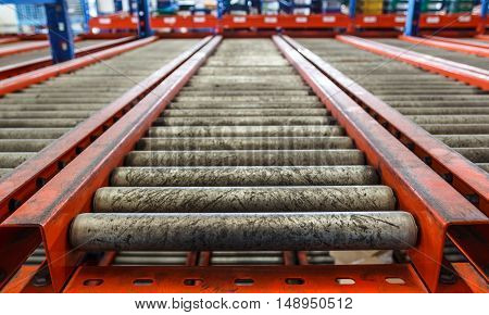 conveyor rollers in distribution warehouse or storehouse