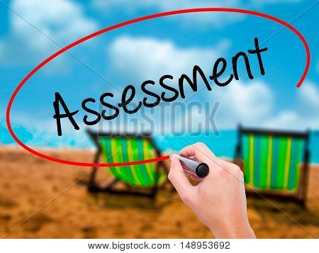 Man Hand Writing Assessment With Black Marker On Visual Screen