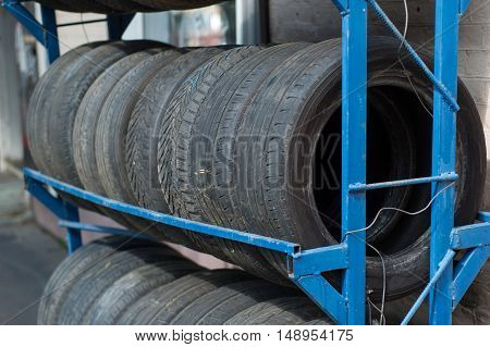 Black tires from cars stacked in a row