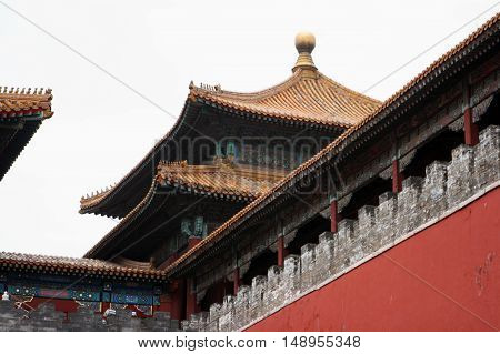 Tiled roof and facade decorated with a Chinese pattern. Palace in the Forbidden City. Chinese symbol. Beijing. China
