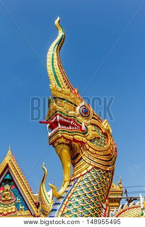 naga statue in thai temple on blue sky background