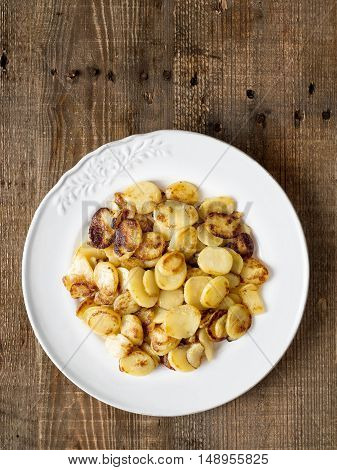 close up of rustic german bratkartofflen fried potatoes