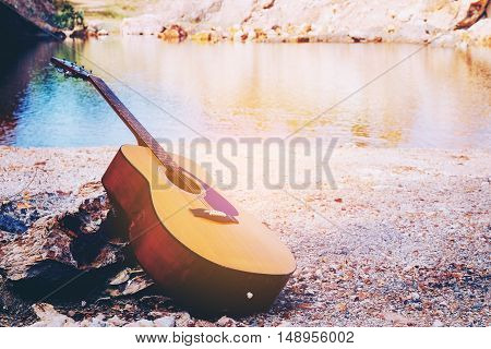 acoustic guitar standing in the outdoor and relax time