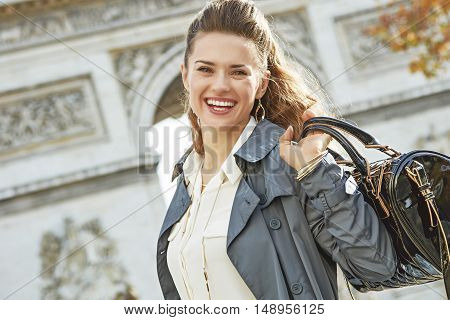 Smiling Elegant Woman Near Arc De Triomphe In Paris, France