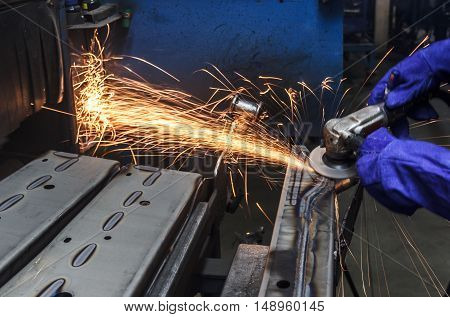 Sparks movement while grinding iron in factory