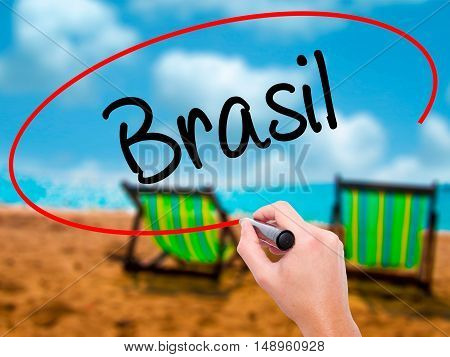 Man Hand Writing Brasil ( Brazil  In Portuguese) With Black Marker On Visual Screen