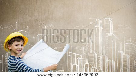 Boy in hard hat holding a plan against drawing of city plan