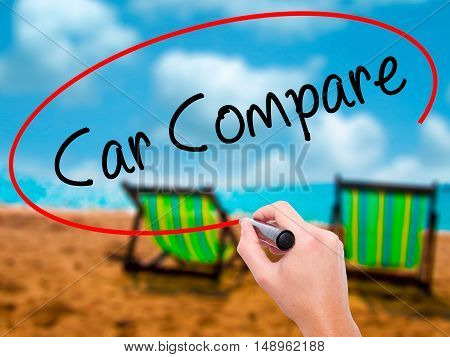 Man Hand Writing Car Compare With Black Marker On Visual Screen
