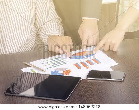 Teamwork business people analyze business chart with light and soft color tone