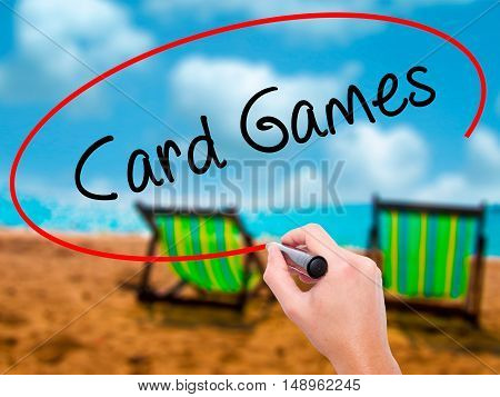 Man Hand Writing Card Games With Black Marker On Visual Screen