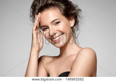 Portrait Of A Smiling Young Pretty Woman With Natural Make-up And Clean Skin