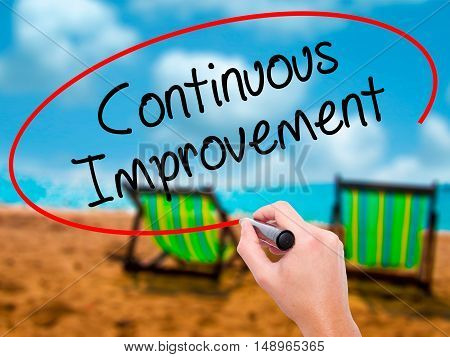 Man Hand Writing Continuous Improvement With Black Marker On Visual Screen
