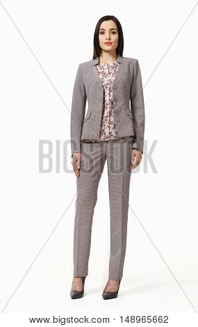 indian business woman with straight hair style in official gray pant suit high heel shoes full body length isolated on white