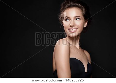 Beautiful Woman With Perfect Smile And Clean Skin On Black Background