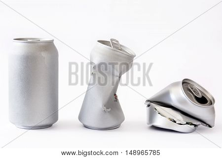 Three silver cans isolated on white background