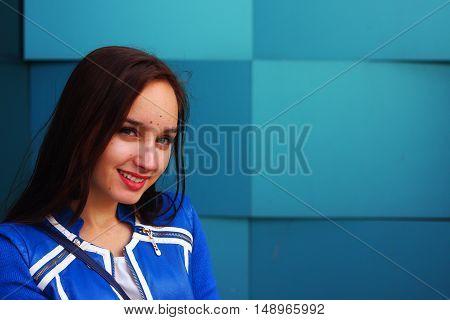 Beautiful girl on blue geometric background russia
