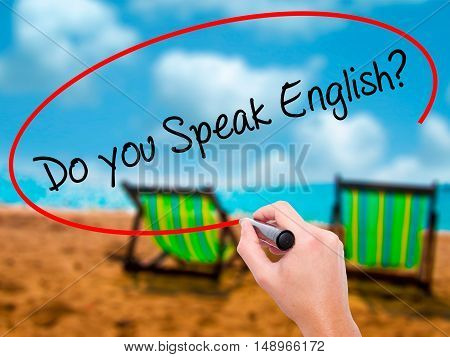 Man Hand Writing  Do You Speak English? With Black Marker On Visual Screen