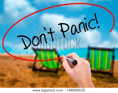 Man Hand Writing Don't Panic! With Black Marker On Visual Screen