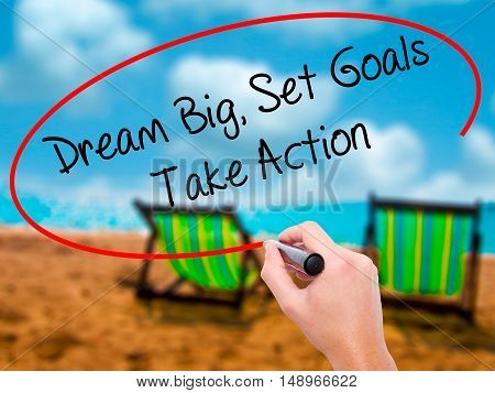 Man Hand Writing Dream Big Set Goals Take Action With Black Marker On Visual Screen