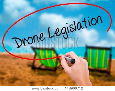 Man Hand Writing Drone Legislation With Black Marker On Visual Screen