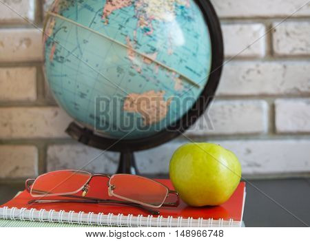 World teachers ' Day in school. Still life with books, globe, Apple glasses