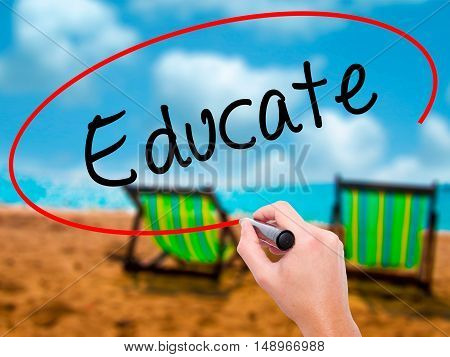 Man Hand Writing Educate With Black Marker On Visual Screen