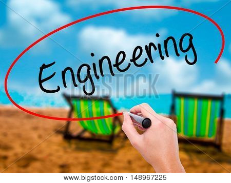 Man Hand Writing Engineering  With Black Marker On Visual Screen