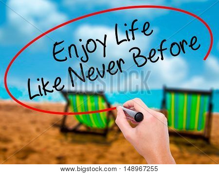 Man Hand Writing Enjoy Life Like Never Before With Black Marker On Visual Screen