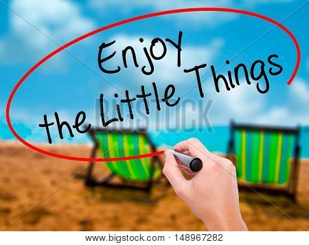 Man Hand Writing  Enjoy The Little Things With Black Marker On Visual Screen