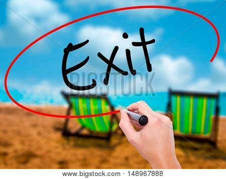 Man Hand Writing Exit With Black Marker On Visual Screen
