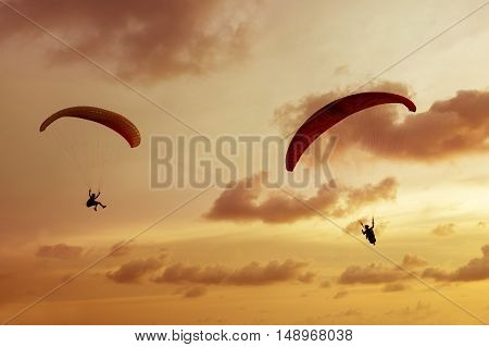 Skydiver flies on background of the cloudy sky background