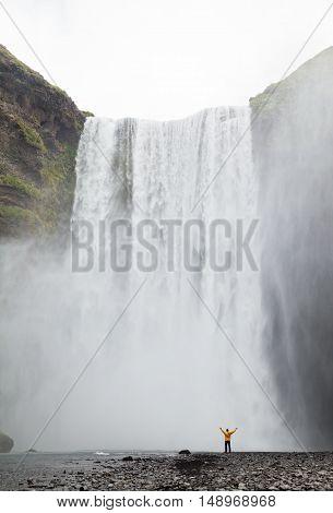 One Man Posing At Skogafoss Waterfall
