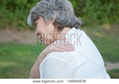 Old age woman suffers from shoulder pain