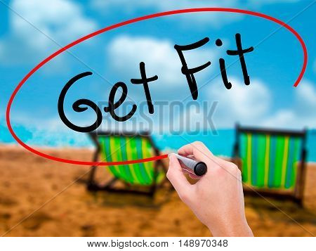 Man Hand Writing Get Fit  With Black Marker On Visual Screen