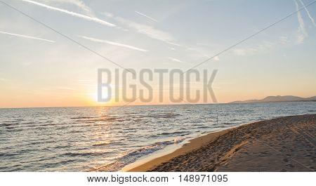 Beautiful sandy beach on the colorful sunset