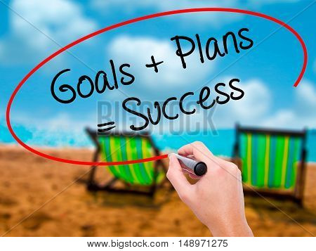 Man Hand Writing Goals + Plans = Success With Black Marker On Visual Screen.
