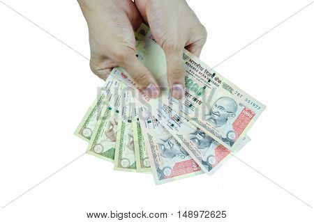 Human Hands Holding Indian Rupee Bank Notes  In White Isolated Background