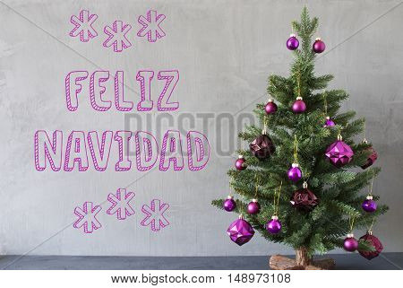 Christmas Tree With Purple Christmas Tree Balls. Card For Seasons Greetings. Gray Cement Or Concrete Wall For Urban, Modern Industrial Styl. Spanish Text Feliz Navidad Means Merry Christmas